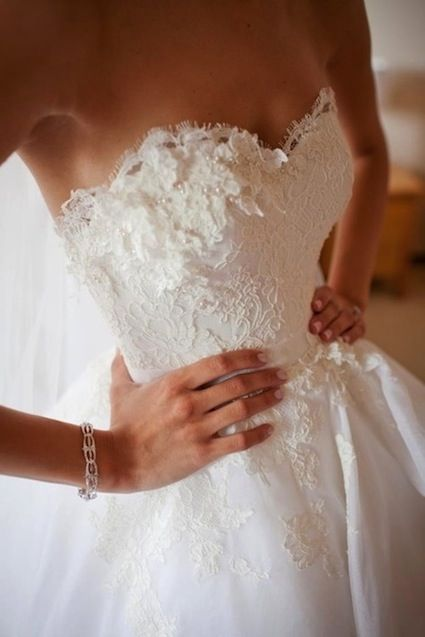 Get Lacey - and who doesn't love lace details on their wedding dress.