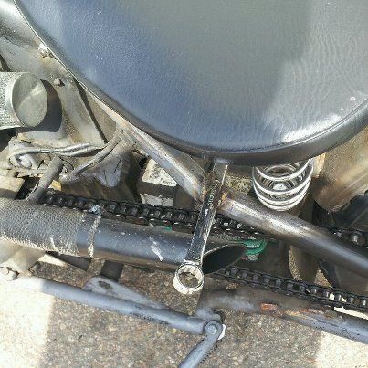 Out of the box (toolbox) innovative use of 9/16 wrenches for rear passenger pegs. Cool!