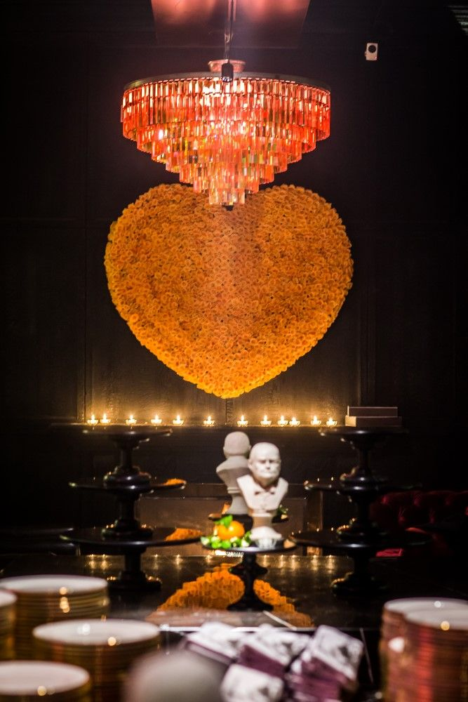 Our opening dinner was a tribute to the love that Winston and Clementine Churchill shared for 56 years together.  The table was filled with 5,000 clementines and vintage Winston busts, leading to a heart made of red roses hung above a roaring fire. Guests were intrigued to find a love letter on the table, written to Clementine in Winston's handwriting on his personal stationery.