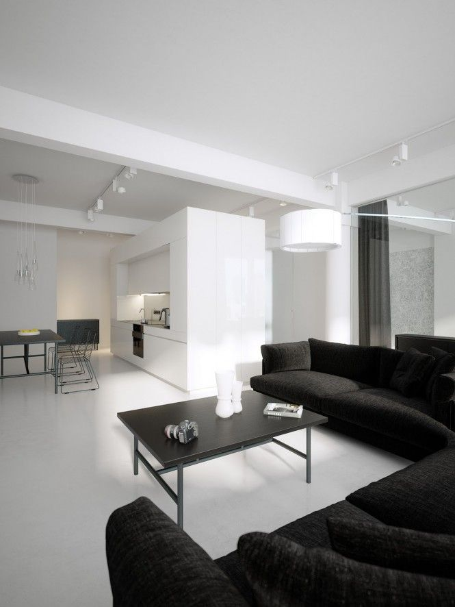 modern minimalist black and white lofts living room lofttwo low profile sofas hug the living space in a large inviting l shape formation, surrounding a coffee table that echoes the refined dimensions and