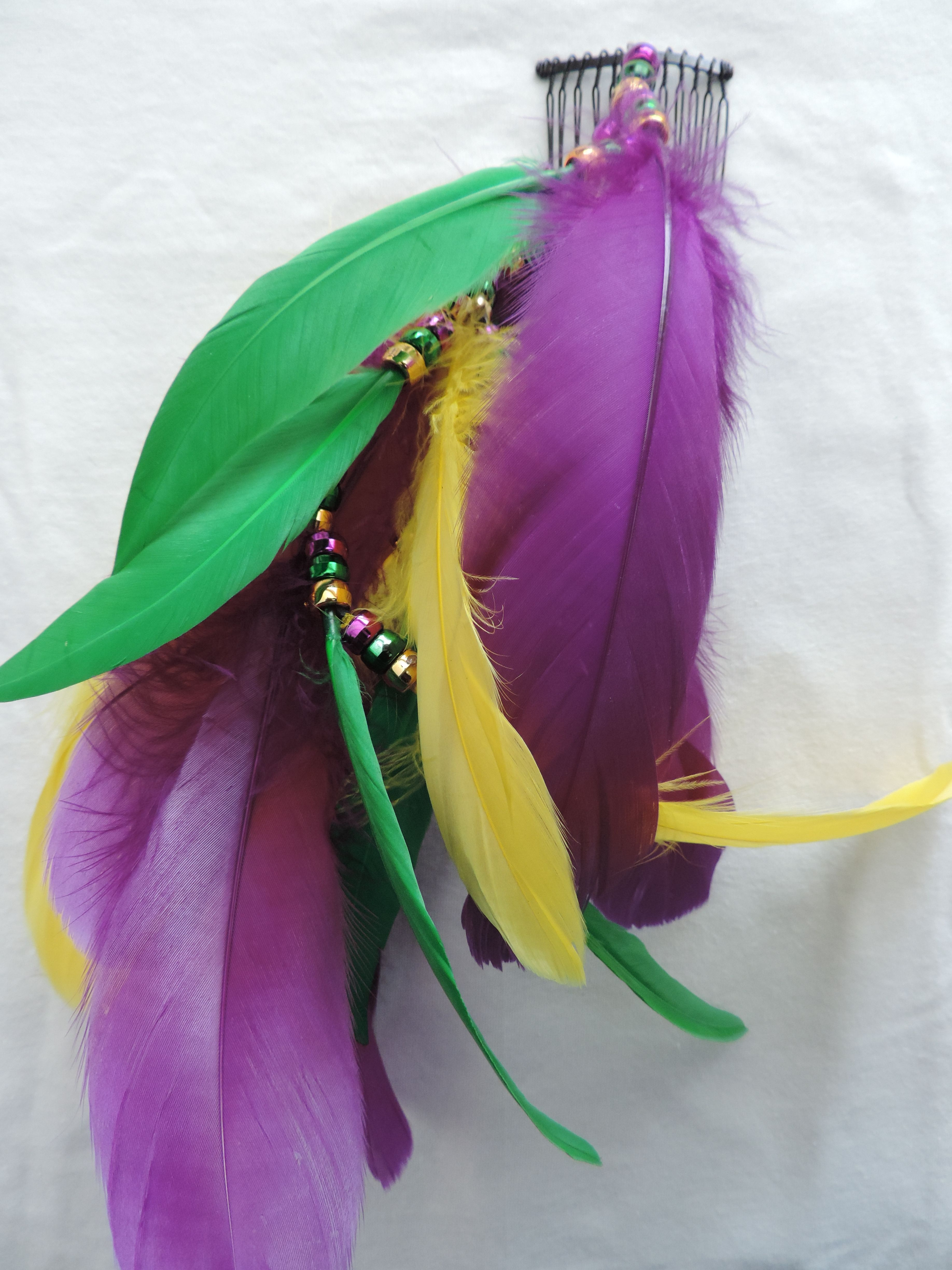 Mardi Gras feather hair comb. Purple green and yellow feather with purple gold and green pony beads.  Make everyday Mardi Gras day!