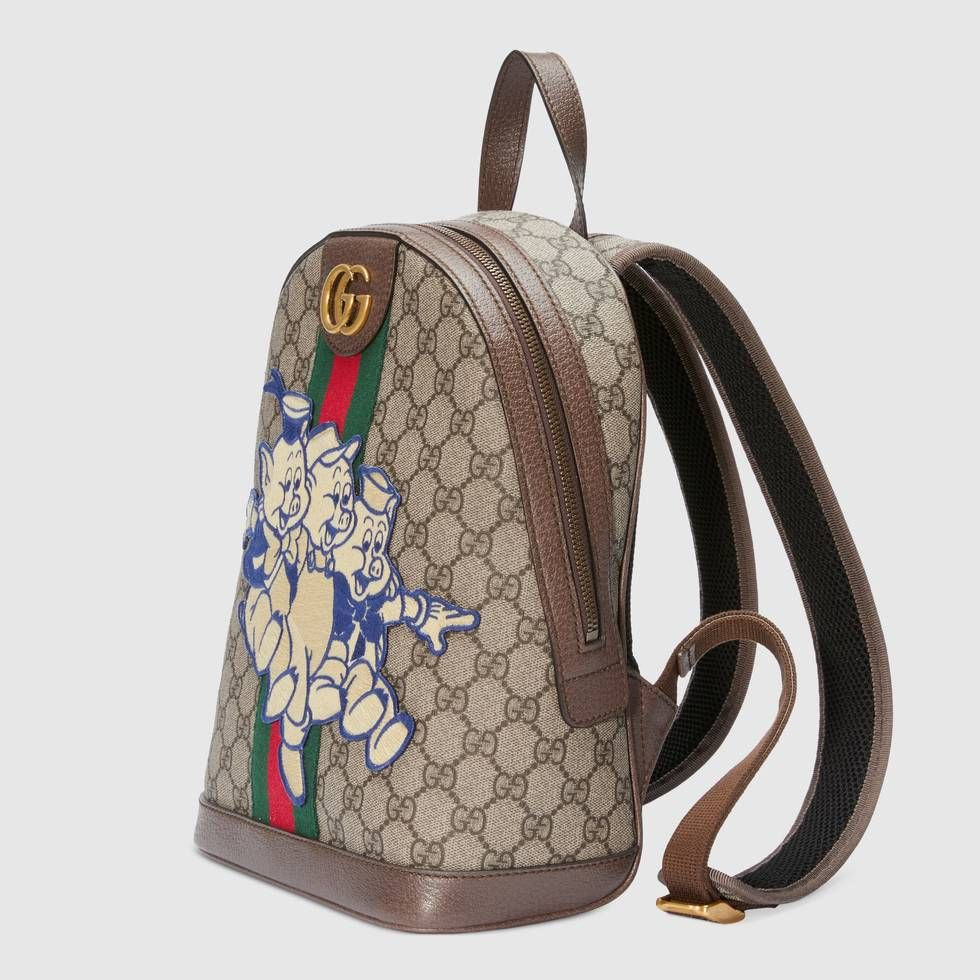 "5440f4e919b8 Shop the Ophidia GG backpack with Three Little Pigs by Gucci. In honor of  the Chinese calendar's year of the pig, the characters from the ""Three  Little ..."