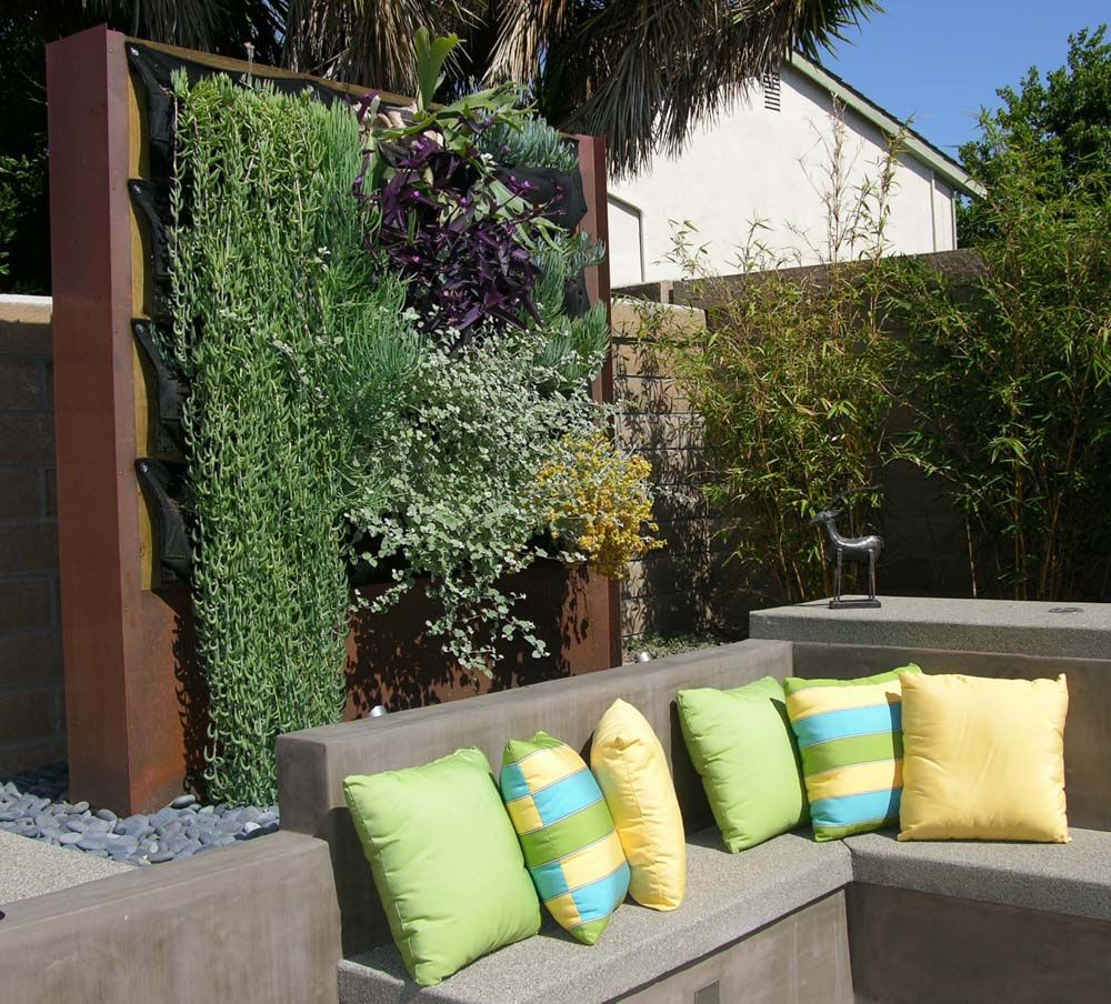 Woolly pocket wall and built in seating outdoor living for Outdoor vertical wall garden