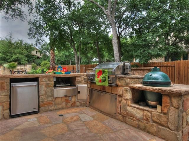 Exceptional Rustic Patio With Exterior Stone Floors, Outdoor Kitchen, Fence, Bayou  Classic Cypress Ceramic Charcoal Grill, Built In Grill