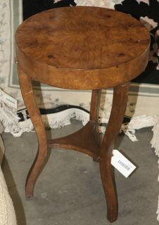 ROUND SIDE TABLE, MADE IN THE PHILIPPINES. APPEARS TO BE MADE OUT OF BURL WOOD/ MAHOGANY.