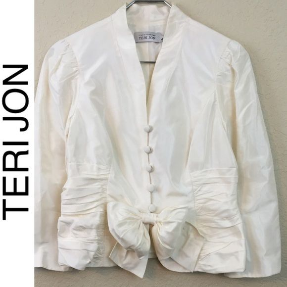 Teri Jon bow jacket Teri Jon 100% silk bow jacket excellent pre loved condition size 6. $370 Teri Jon Jackets & Coats