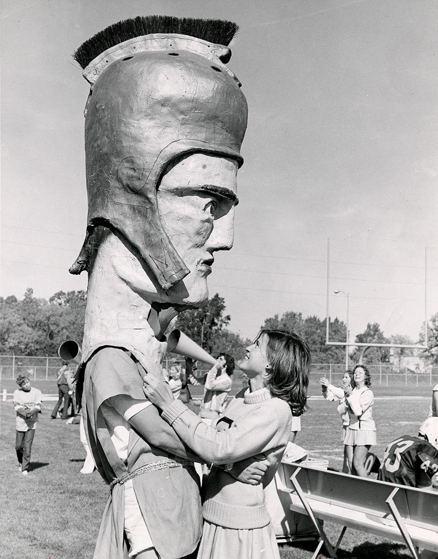 A cheerleader with Titan Tommy, the University of Wisconsin-Oshkosh ...