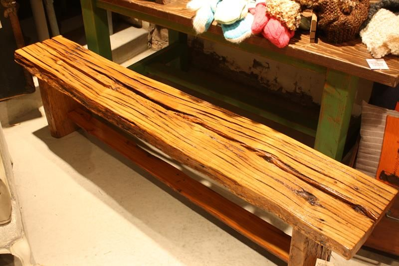 Old Telephone Pole Sawn Lengthwise And Made Into A Bench