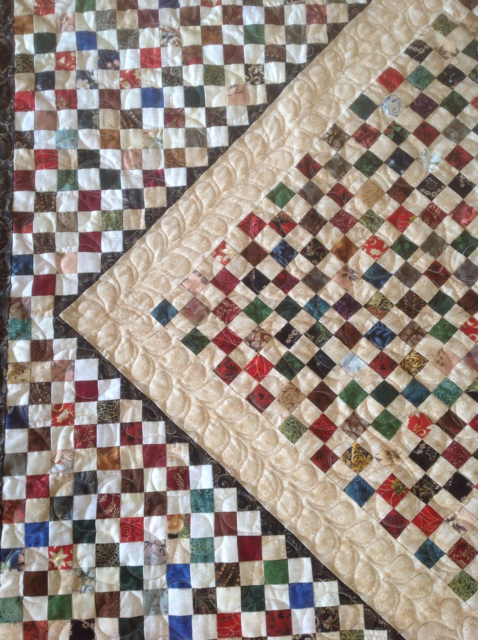 Close Up Of Scrappy Postage Stamp Quilt Made From 1