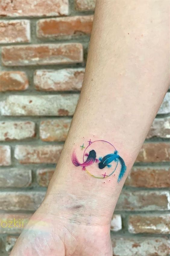 Pink And Blue Pisces Koi Fish Tattoo On The Wrist Www Otziapp Com Delicate Tattoos For Women Wrist Tattoos For Guys Watercolor Wrist Tattoo