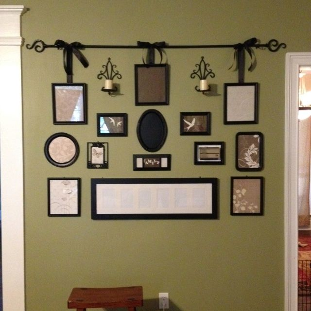 gallery wall from various old picture frames painted black curtain rod black ribbon dollar tree serving trays painted black and scrapbook paper