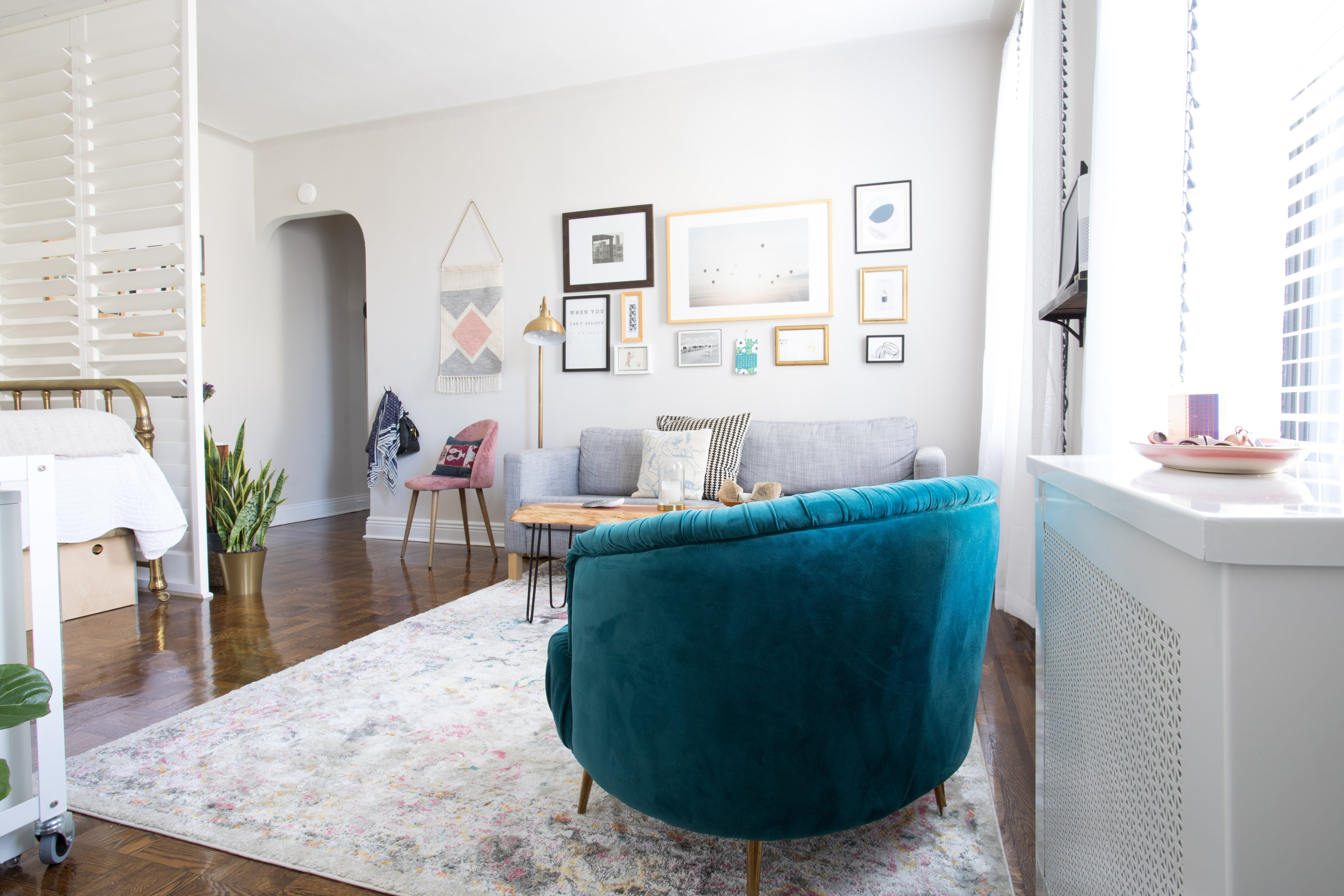 Creating Clear Vignettes Using Furniture And Art Helped To Define