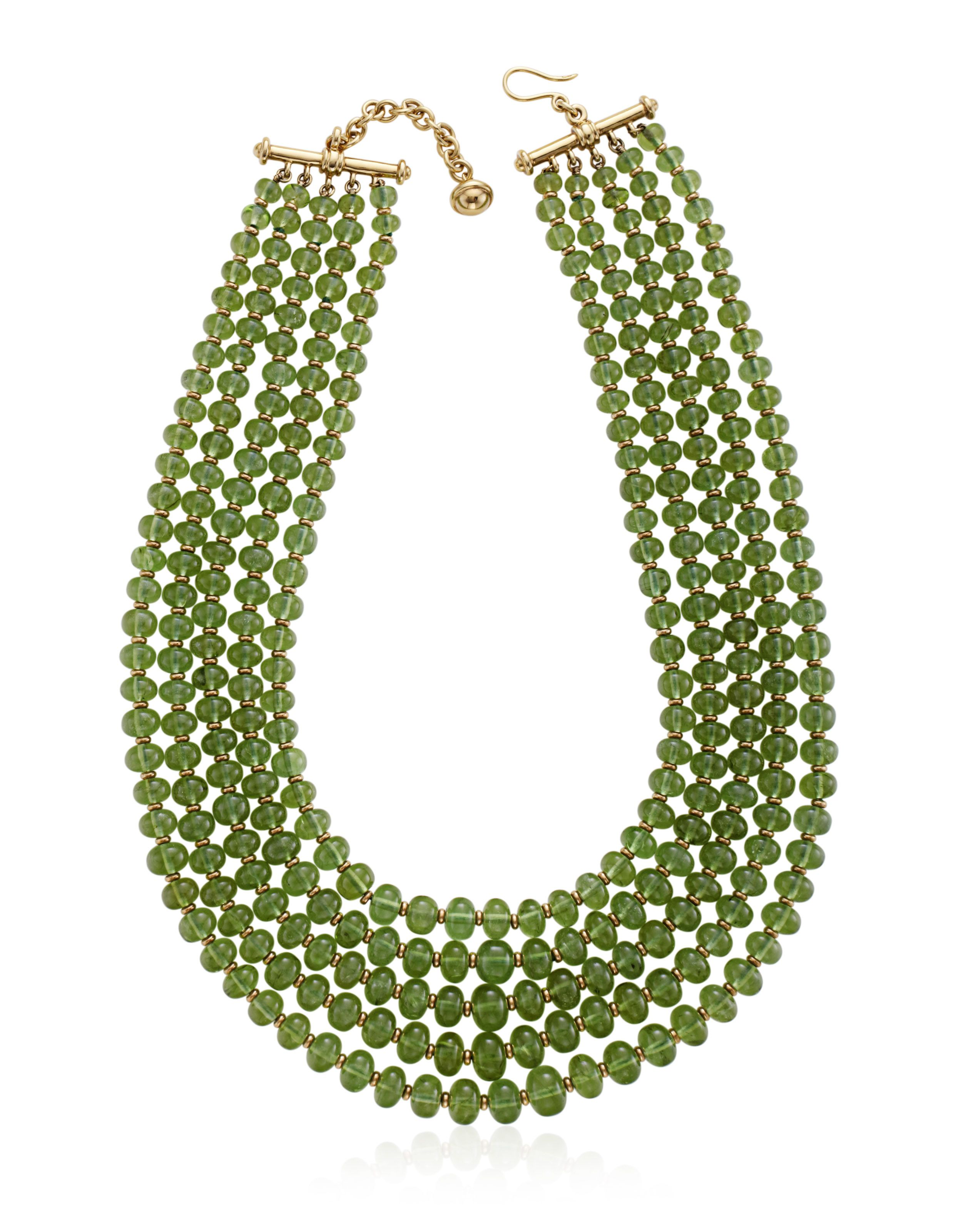 64369e315 TIFFANY & CO. PALOMA PICASSO PERIDOT BEAD NECKLACEDesigned as five strands  of peridot beads spaced by gold rondelles with a gold claspMetal: 18K  yellow ...