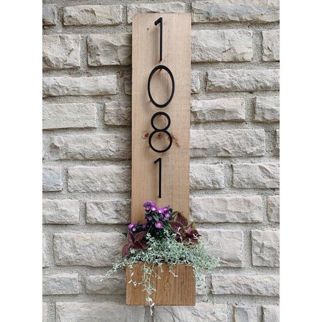 Guests with an Address Planter Plaque.