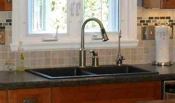 Black drop in kitchen sink by McClurg Remodeling   Construction Services. Black drop in kitchen sink by McClurg Remodeling   Construction