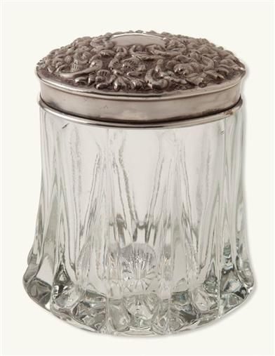 """Florence Vanity Jar = A cut glass container befitting an Edwardian dressing table tidies cotton balls, hairpins, and toiletries. Embossed floral brass lid. 7""""H x 4""""W. Not for food use. Z"""