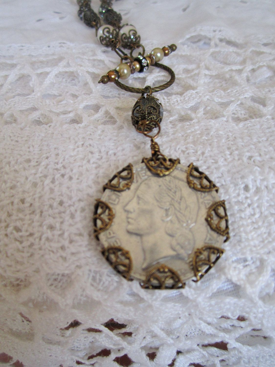 great idea to wrap a vintage coin in filigree...can't believe I didn't think about this before