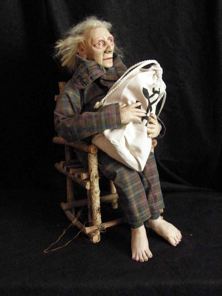 Miser doll polymer clay and wrapped wire armature construction.