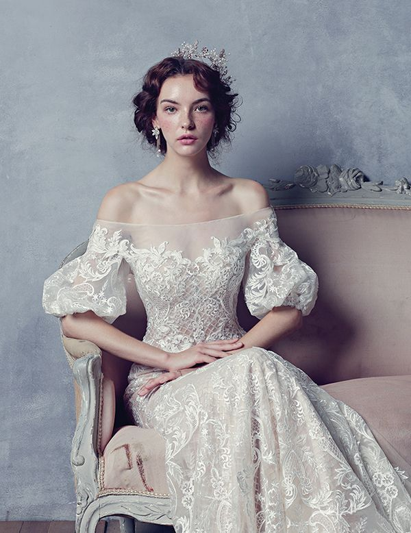 This vintage-inspired gown from Blanc Neul featuring delicate lace embroideries …