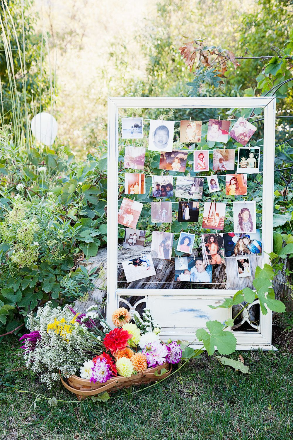 Backyard wedding Hanging pictures of the bride