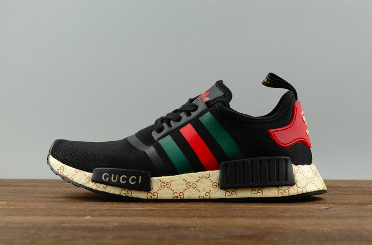 quality design b40d2 ec2e6 THE ADIDAS NMD RETURNS WITH A GUCCI TWIST Elevating athletic performance  with their innovative designs, adidas presents the new NMD R1 Athletic Shoes .