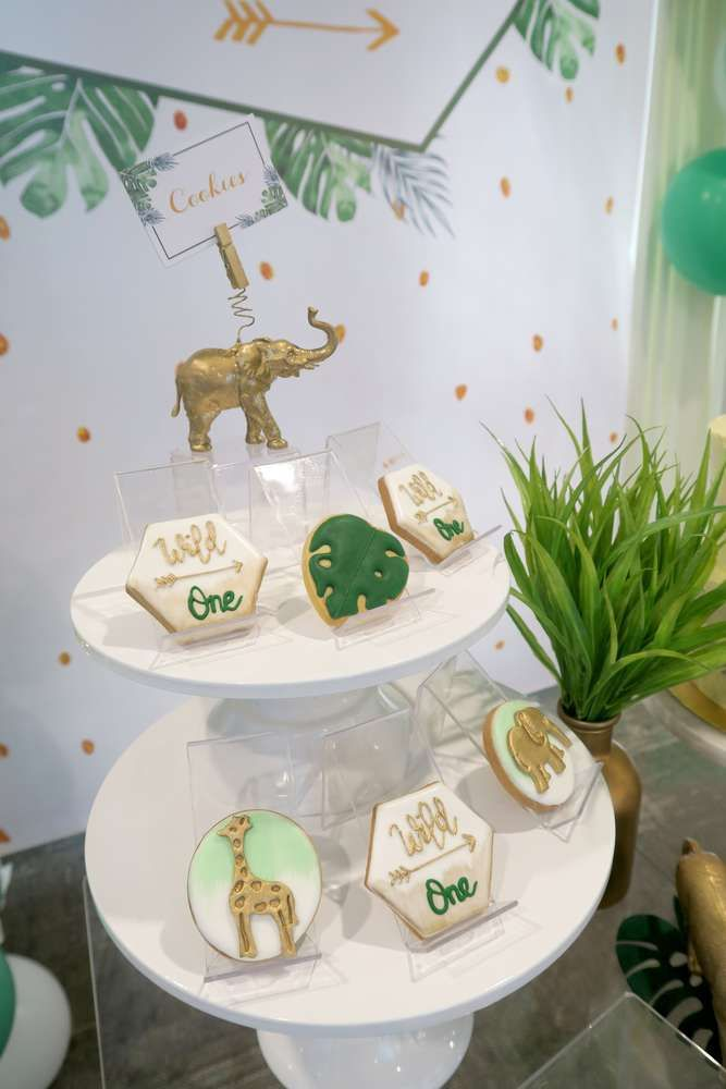 Don't miss this awesome Wild One Safari 1st birthday party! The dessert table is fantastic! See more party ideas and share yours at CatchMyParty.com #catchmyparty #partyideas #wildone #boy1stbirthdayparty #safariparty #jungleparty #safaricookies #safaribirthdayparty