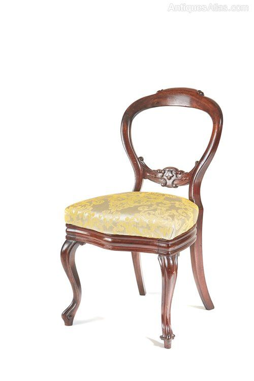A Victorian Mahogany Occasional Chair,the Shaped Back With A Carved Lower  Rail,standing On Cabriole Front Legs Outswept Back Legs