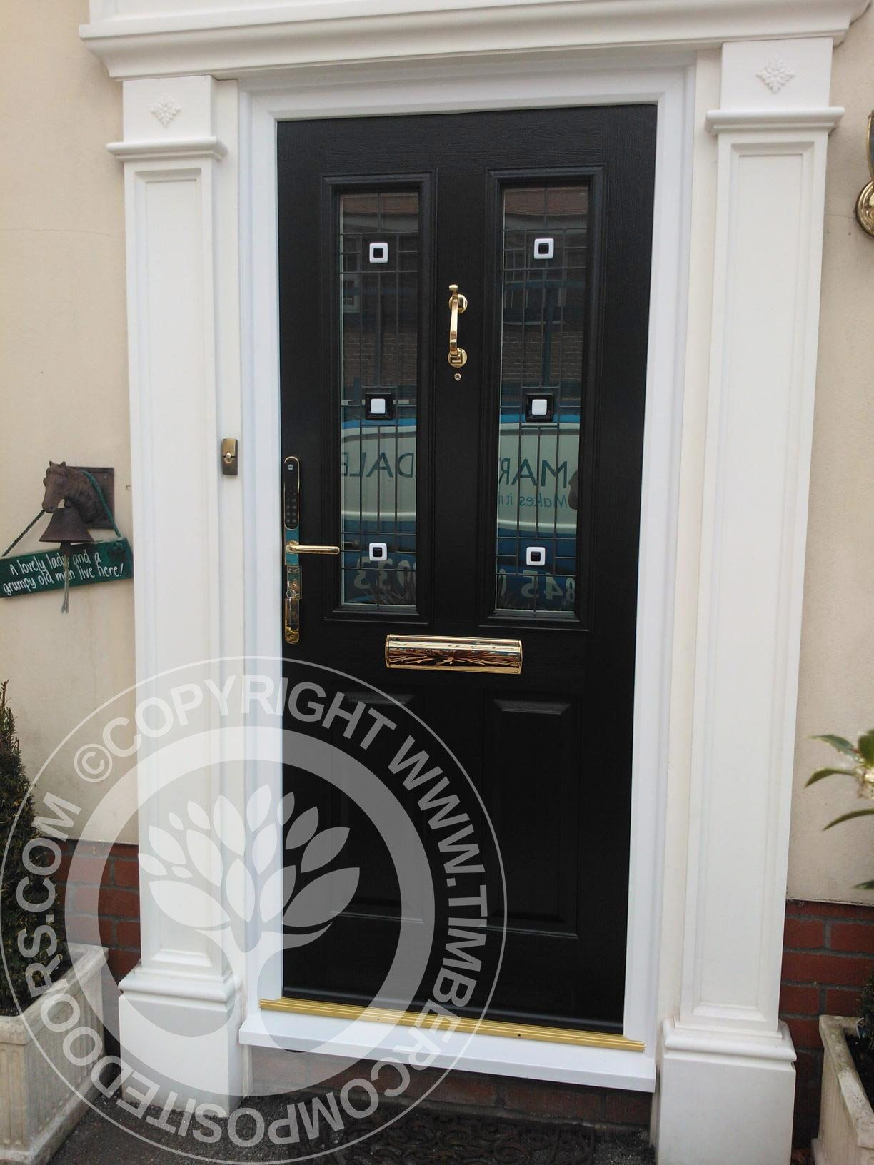 Black Solidor Ludlow Composite Door with gold hardware and stunning ...