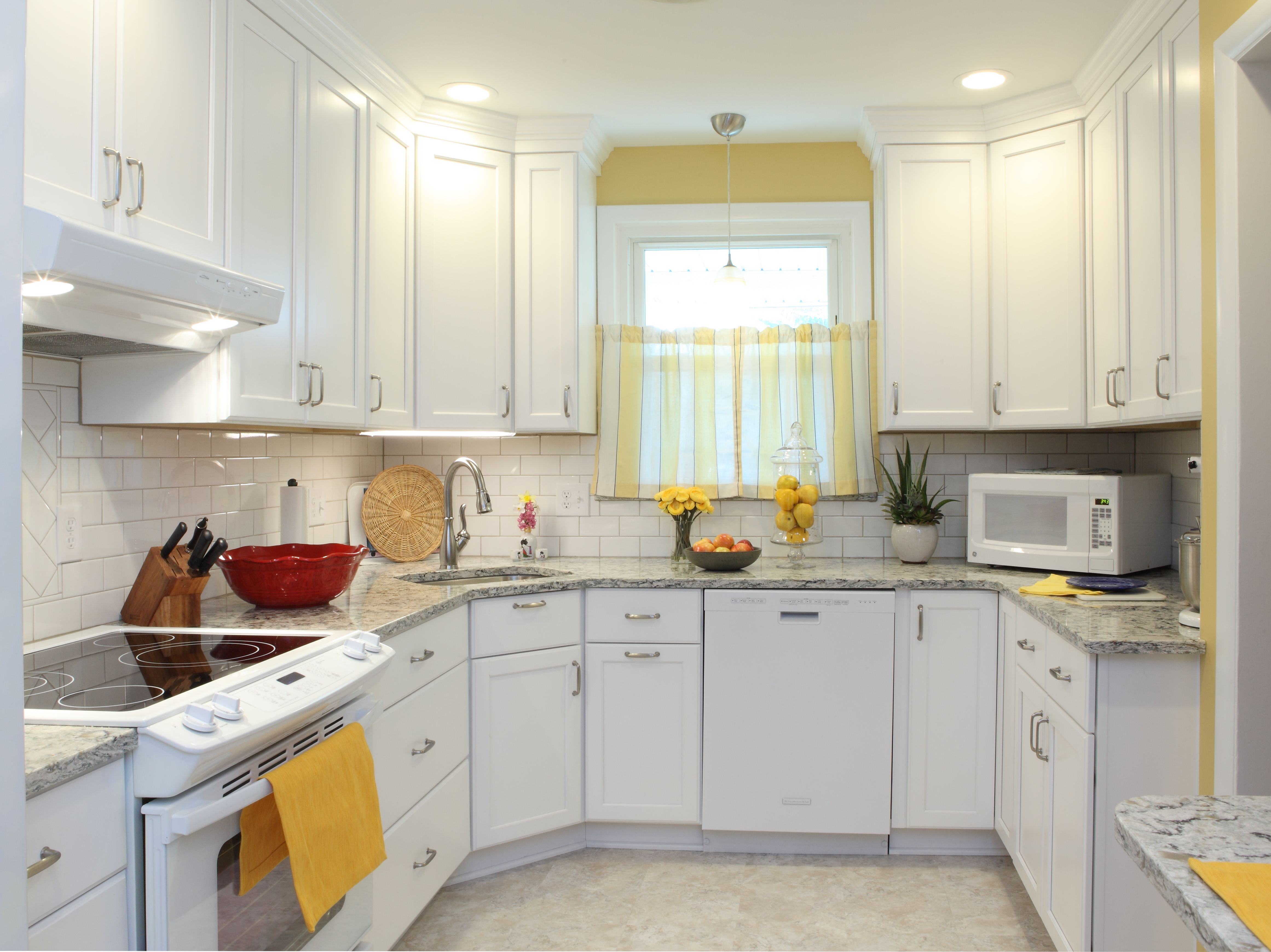 Full height white cabinets with matching crown molding. Quartz ...