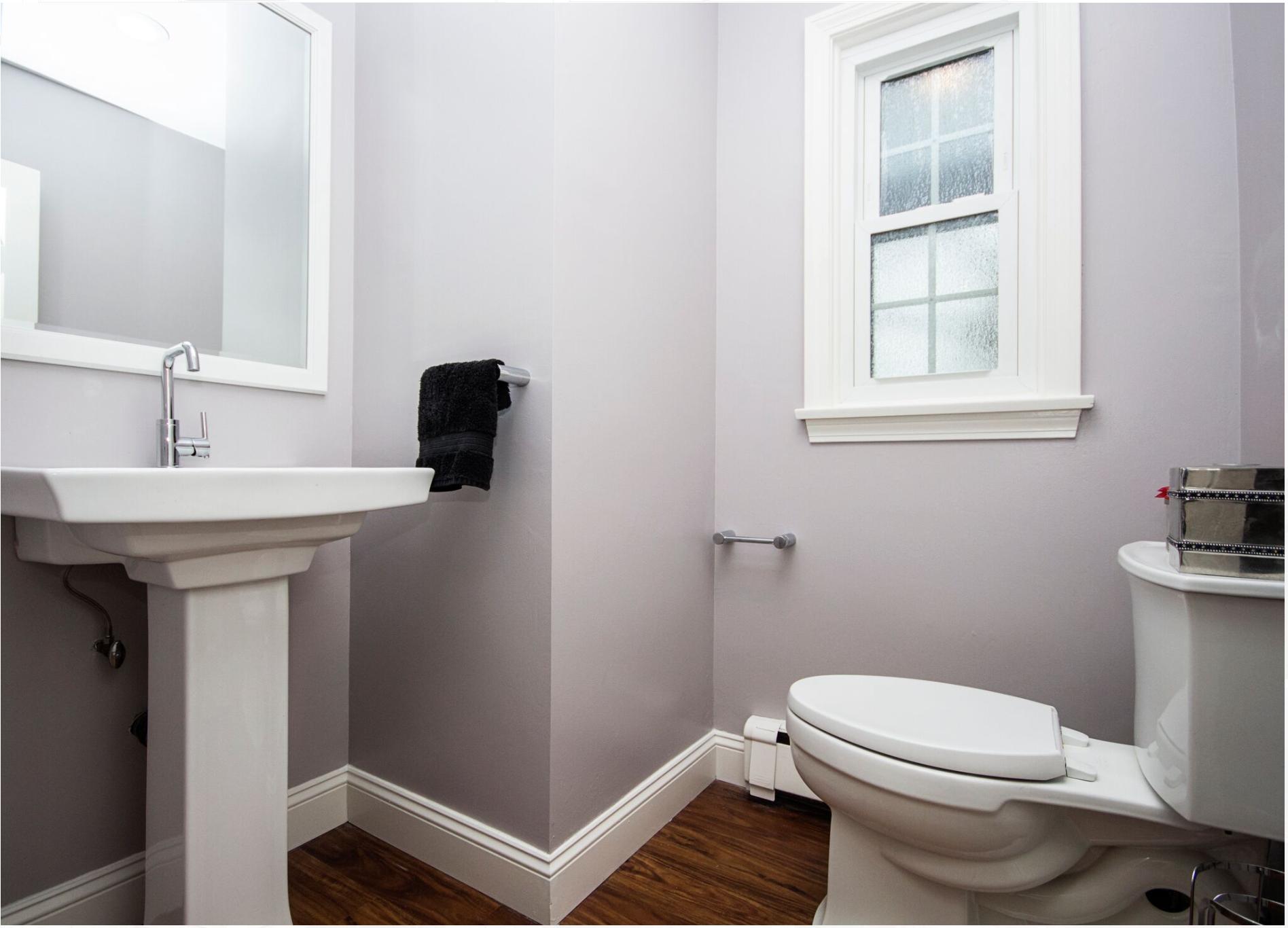 Guest Bathroom Featuring White Kohler Pedestal Sink Kohler Toilet