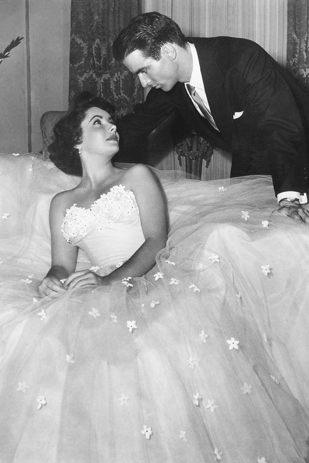Costume designer Edith Head won one of her eight Academy Awards for costume design by designing the prom-style ball gown worn by Elizabeth Taylor in A Place in the Sun, and, when looking closely at the dress, we can see why. With a fixed bodice and flowing netted skirt, this piece is the definition of iconic.