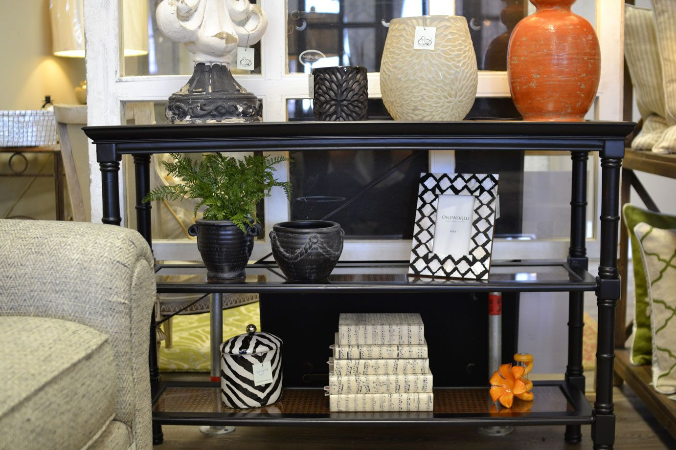 Black and wicker side table with shelves.  Robin's Nest Interiors - Louisville Interior Design & Home Accessories Boutique located in the heart of Middletown, KY.