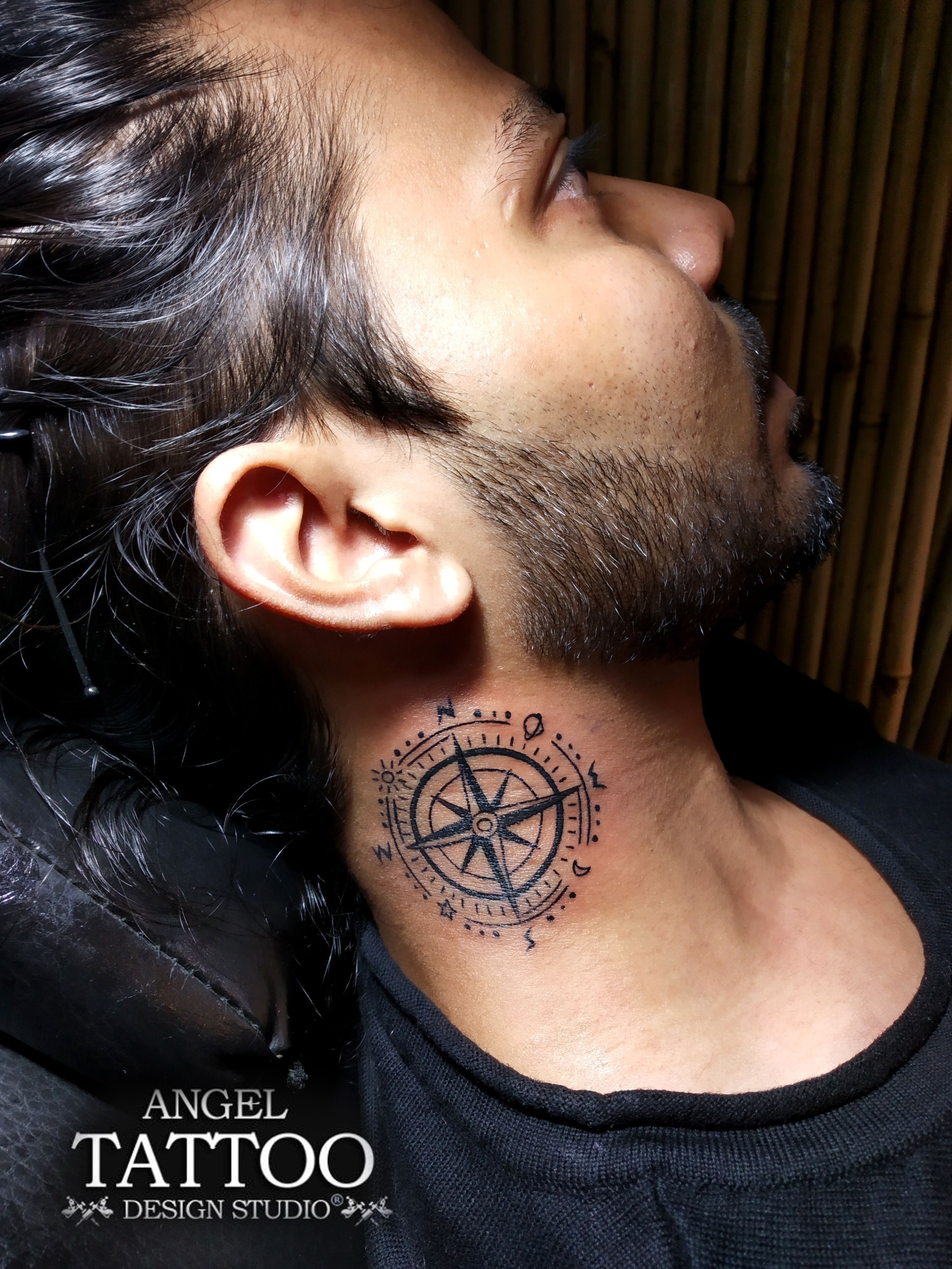 Compass tattoo on neck made at gurgaon tattoo center