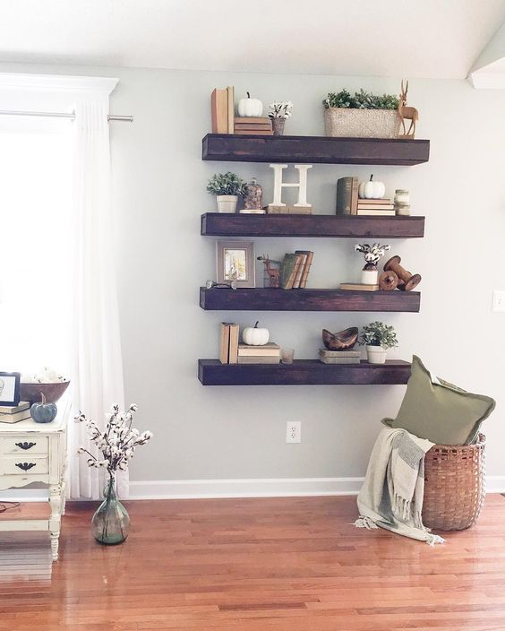 Thick Dark Stained Wood Shelves Make A Statement In Light Colored E Wall Decor For