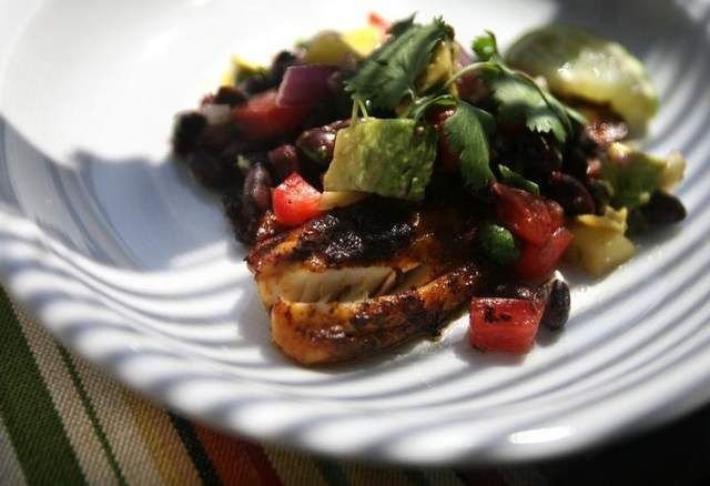 This recipe for Chili-Rubbed Tilapia with Mango Salsa provides a good dose of fiber with 12 grams per serving.