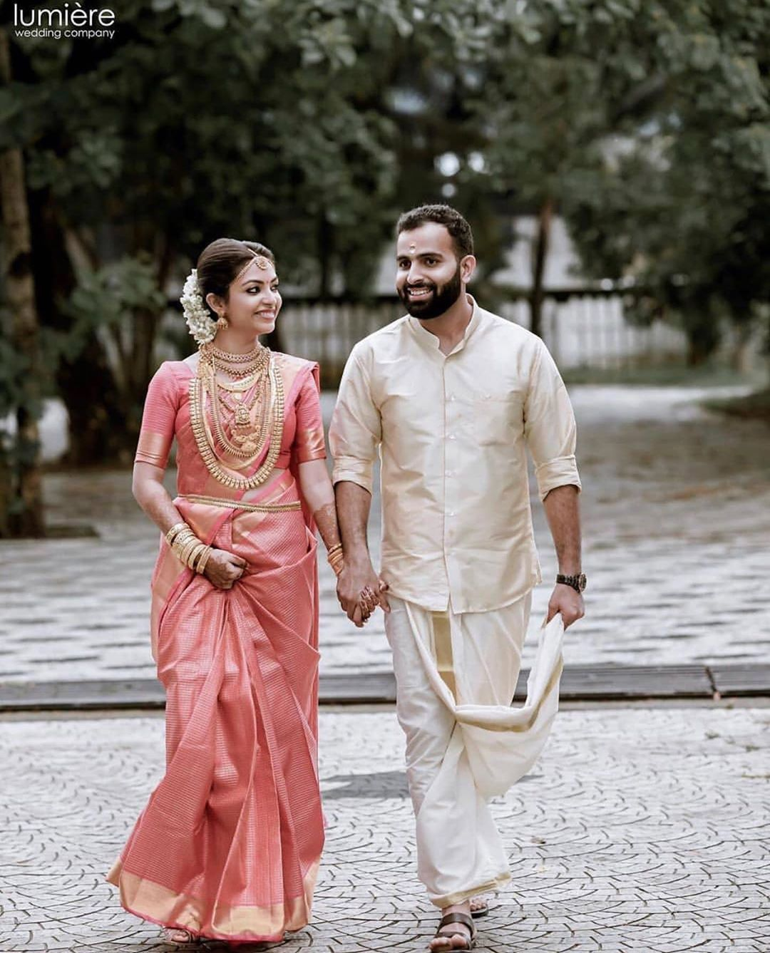 Photo of South Indian couple Pink saree Panche