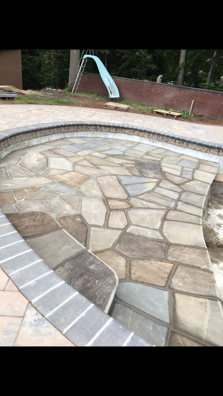 Job in progress: Check out this Unbelievable pool in West Nyack NY❗️❗️Lounging area built with free form bluestone inside pool to give this backyard the perfect look❗️❗️#mrlandscapeinc inc #pool #freeform #bluestone #beautiful #slabs #lounging #area #rocklandcounty #tristatearea #845 #westnyack #thebest #wedoitall #wegiveyouwhatyouwant
