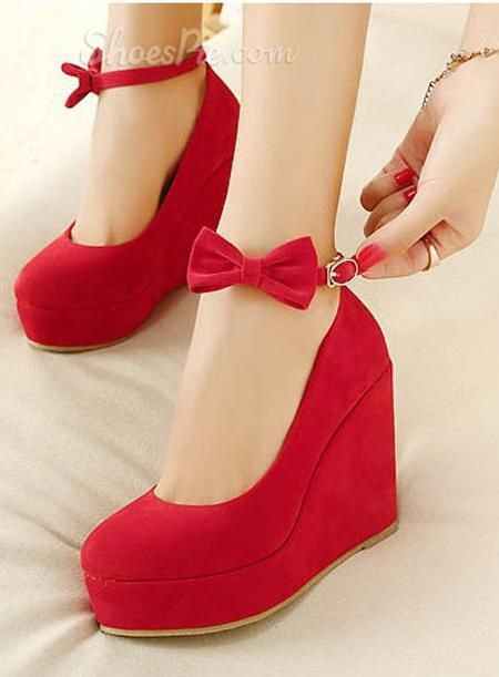 Red wedge heels with bow ankle strap. My goodness are these just ...
