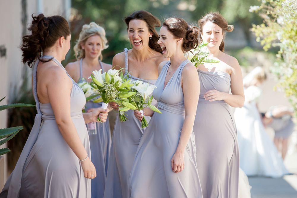 Spontaneous Laugh Amongst Bridesmaids Grey Infitiy Dresses White Lily Wedding Bouquets U Donne