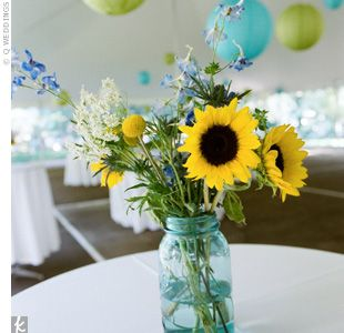 Centerpiece: Flowers in a blue mason jar
