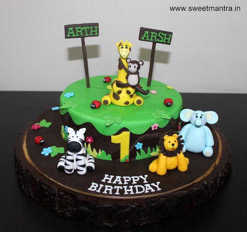 Animal Jungle Theme Customized Designer Fondant Cake For Twin Boys 1st Birthday At Pune Twins Cake Cartoon Birthday Cake Cake Home Delivery