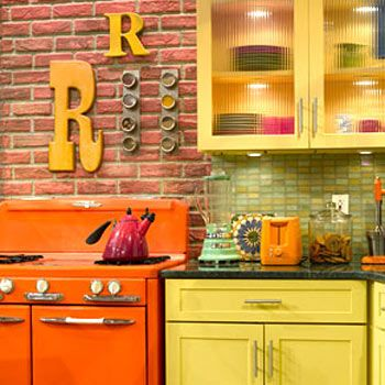 """INITIAL THOUGHT  Rachael loves personalized touches—what better way to show off her double initials than with these cute Rs on the wall? Want to put up your own monogram? Check out your local craft store for materials. And those """"brick"""" walls? They're actually made of lightweight plastic!"""
