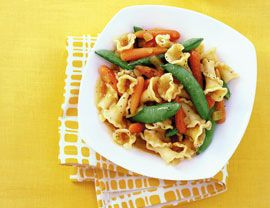 """To ensure that the """"buttery"""" sauce in this dish doesn't get watered down, dry the vegetables well after steaming. A high-grade, unrefined corn oil is a worthy investment for this recipe as it gives the """"butter"""" a rich flavor. This recipes is a fantastic side dish or works well tossed with pasta too! Snap Peas and Baby Carrots in Carrot """"Butter"""", 3.0 out of 4 based on 1 rating"""