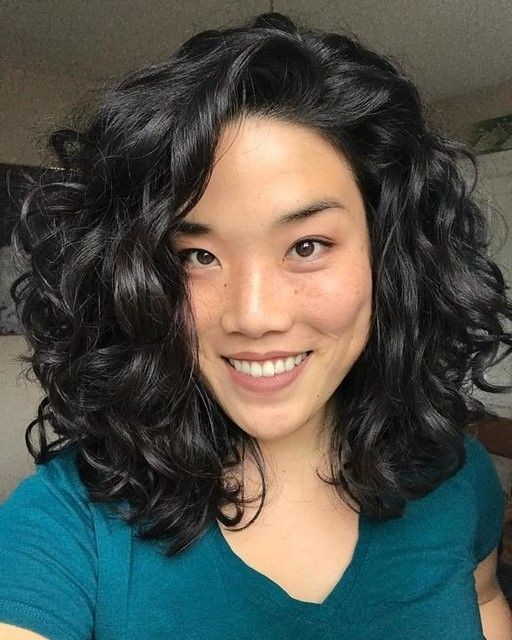 An Asian woman with beautiful shoulder-length curly hair
