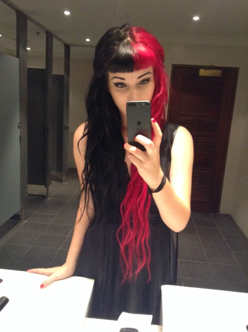 two colors hair, red and black, long hair and bangs maybe
