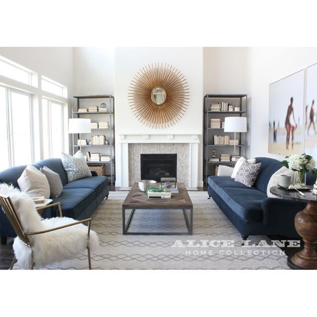 Decorating Ideas For Living Room With White Walls: Midnight Blue Couch, White Walls, Starburst Mirror