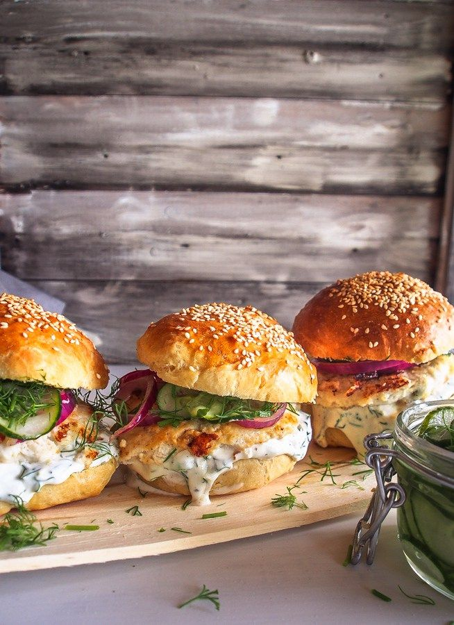 Perfect fish burgers with pickled cucumber, red onion and dill dressing