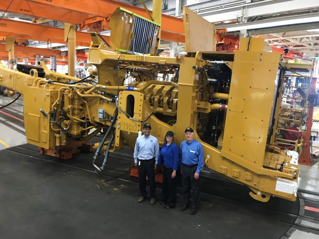 Caterpillar employees mark the production of the 5,000th