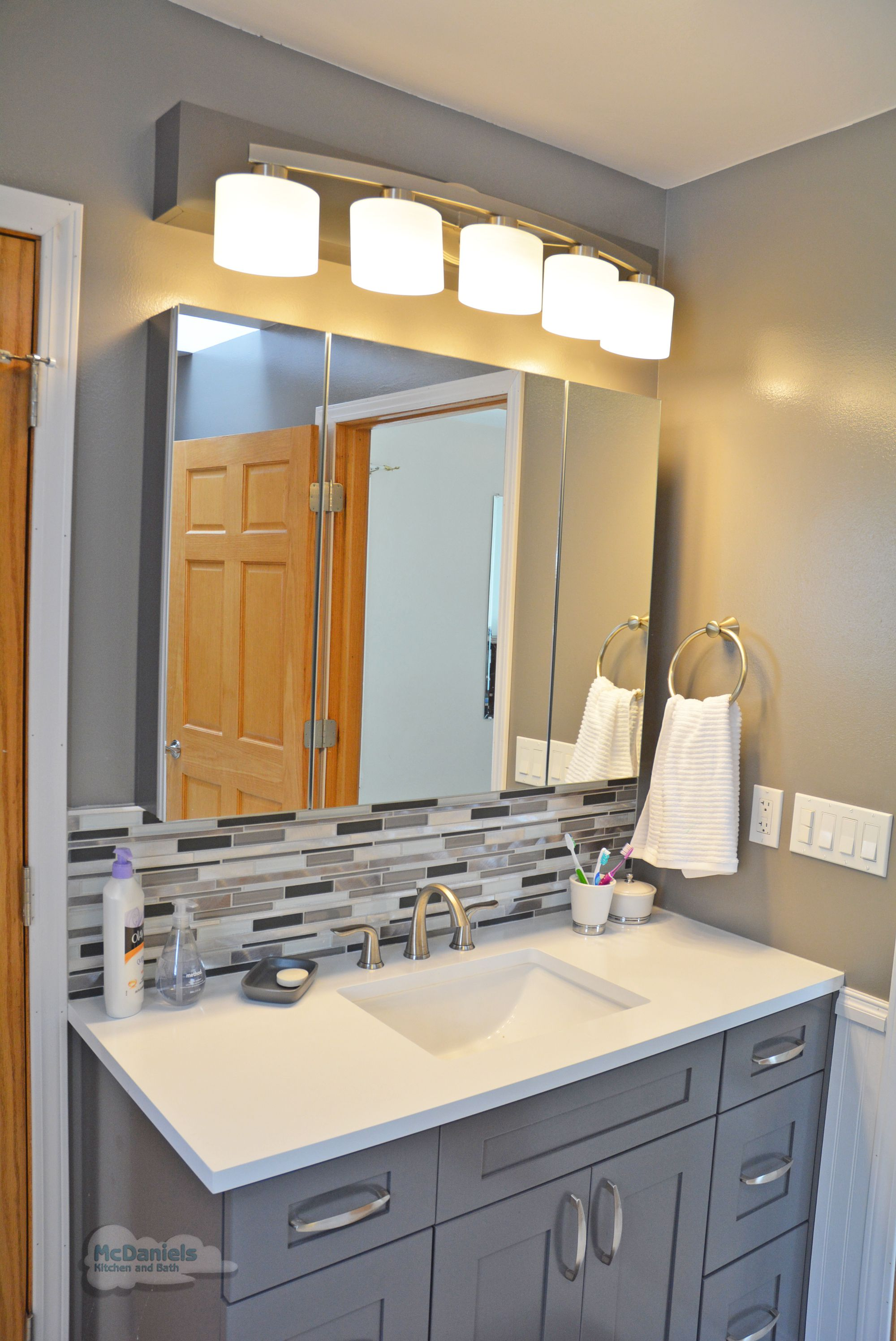 This Contemporary Bathroom Design In A Cool Gray Color Scheme Offers A Relaxing Space The Gra Bathroom Design Tile Backsplash Bathroom Small Bathroom Remodel New bathroom backsplash ideas home