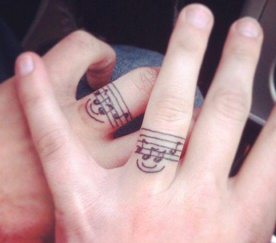 Music ring tattoo